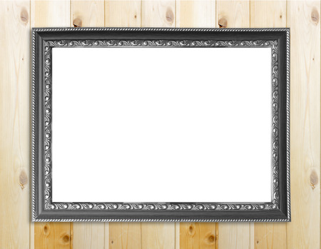 imagery: Empty picture frame on wooden wall. Stock Photo