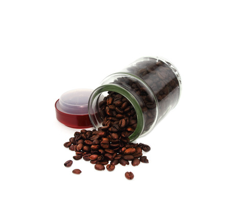 Coffee beans in a bottle on white background