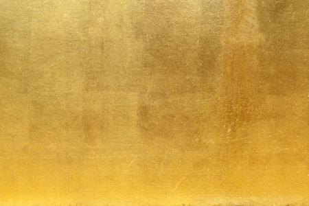 Pared de oro para el fondo o la textura