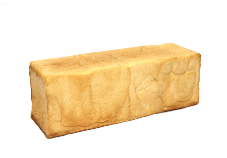 square loaf of bread is isolated on a white background.