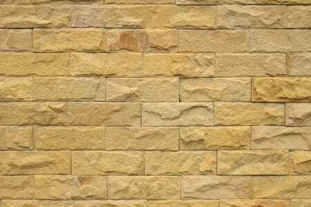 Sandstone yellow wall texture for background.