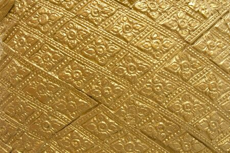 Background of Gold decorative pattern,Traditional thai design in Thailand Temple wall Reklamní fotografie - 143528532