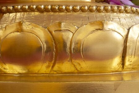 beautiful golden lotus flower petal stucco pattern background in Thai temple.