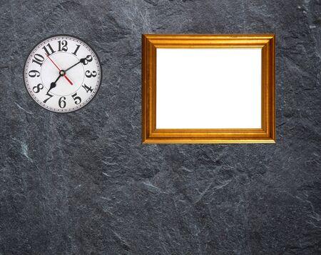 Antique clocks and gold picture frames On a black marble  Reklamní fotografie
