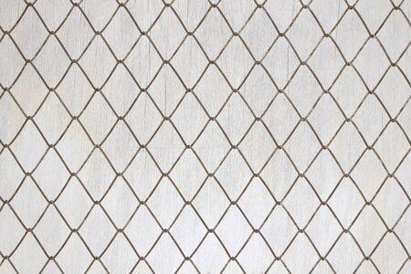 Iron mesh on old white wood background