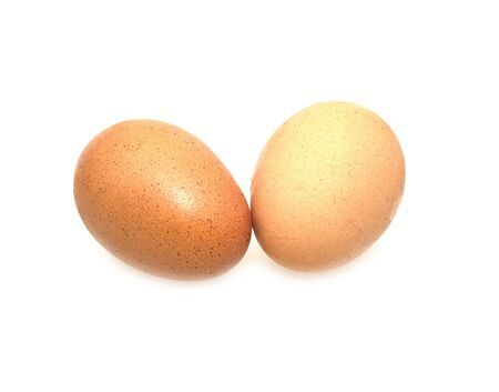 two eggs are isolated on a white background .