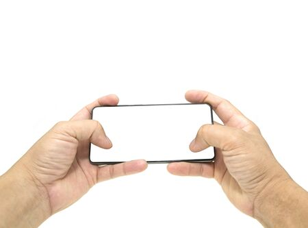 Human hand holding a virtual cell phone is playing game or watching movie