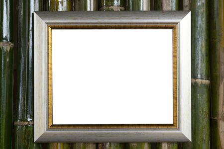 wooden photo frame on bamboo wall background