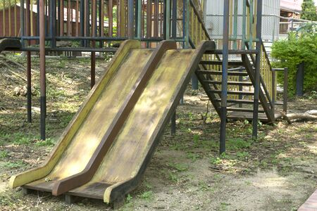 An old metal slide in playground.