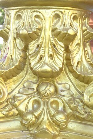 Golden stucco sculpture in Thai temples