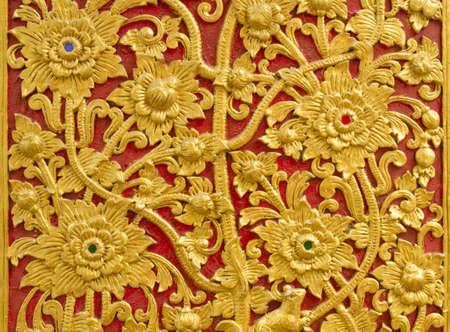 Closeup Golden carve on door, Temple in Thailand