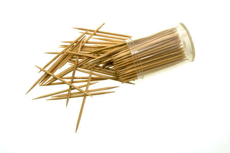 Wooden toothpicks in the plastic jar, isolated on white background.