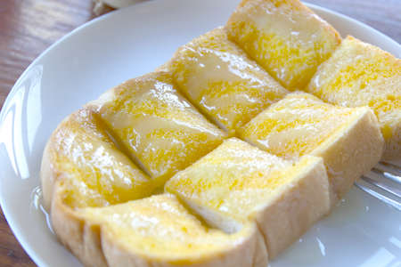 Bread toast with butter sugar and condensed milk Reklamní fotografie