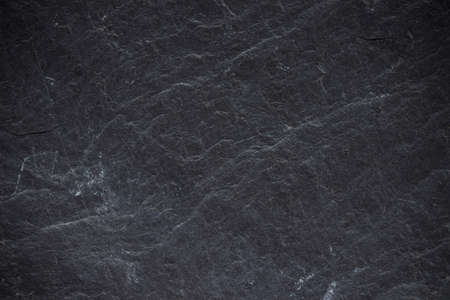 Dark grey black slate background or texture. Black granite Standard-Bild