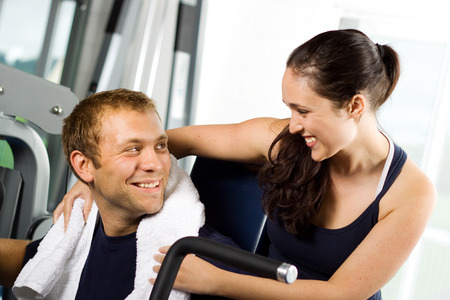 Attractive young couple working out in the gym photo