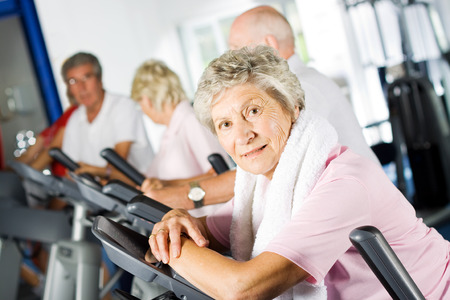 woman working out: Group of older mature people exercising in the gym Stock Photo