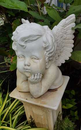 Isolate white roman cupid Statue