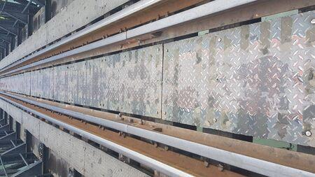 Rusty old steel train rail