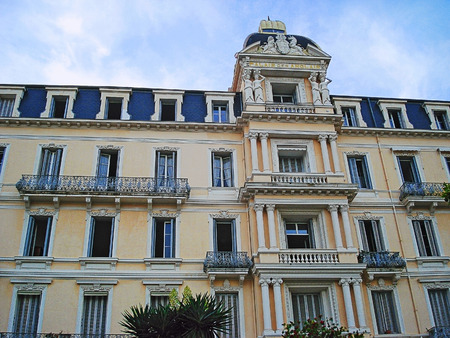 two floors: Palais des Anglais on the street 8 May 1945. Originally in 1885 the Palace was composed of two floors only. Shortly a 3rd floor was built, state-covered an adorned with dormer windows.  In those days it was one of the finest hotels Editorial