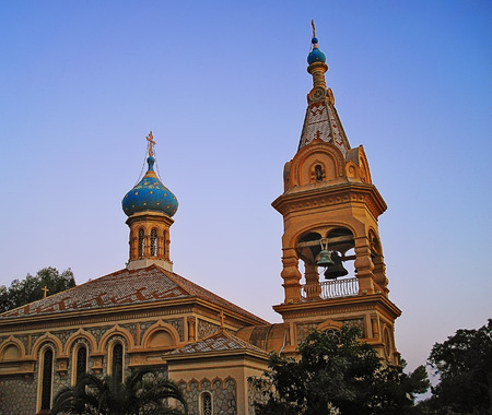 dome and belltower of Russian Orthodox Church in the city of Cannes at sunset