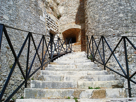 loophole: In this photo you can see a ladder in medieval fortress, fortifications from the stone bleached by the sun and a window - loophole Stock Photo