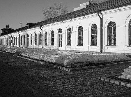 soccer world cup: Historic buildings of Yekaterinburg Mint and mechanical factory. Today here the Museum of the Nature is located. On a background the ancient water tower is visible. In Yekaterinburg in 2018 will pass the soccer World Cup. Black and white picture with rhyt Editorial