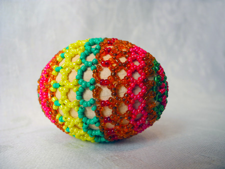 pascha: The symbol of Easter - egg, embroidered with beads, close-up.