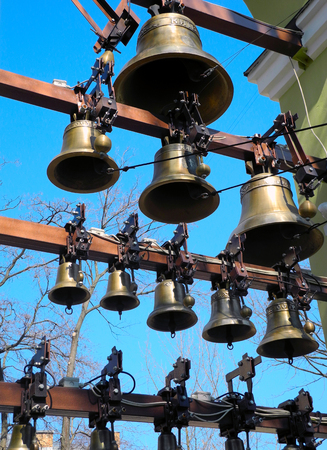 bell tower: The bells in the bell tower of the Christian church.