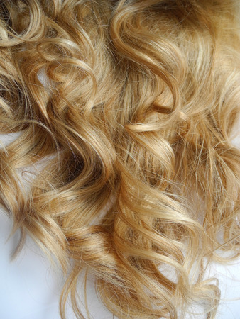 Blonde womens curly hair close up. Stock Photo