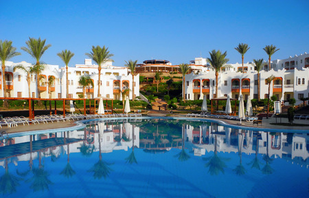 Sharm El Sheikh, Egypt - August 25, 2016: Swimming pool and palm trees at the resort in Sharm El Sheikh. Editorial