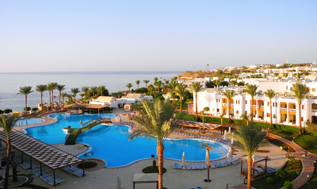 Sharm El Sheikh, Egypt - August 22, 2016: Swimming pool and palm trees at the resort in Sharm El Sheikh.