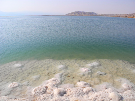 recuperation: Salt of Dead Sea on the beach in Israel.