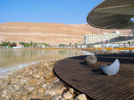 recuperation: Ein Bokek, Israel - August 23, 2016: Chairs on the public beach of Dead Sea resort.