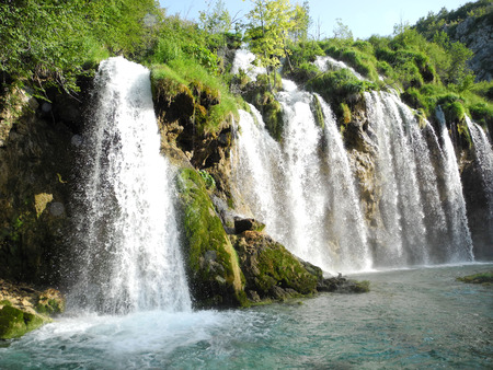 The waterfalls of Plitvice lakes in the summer, Croatia.