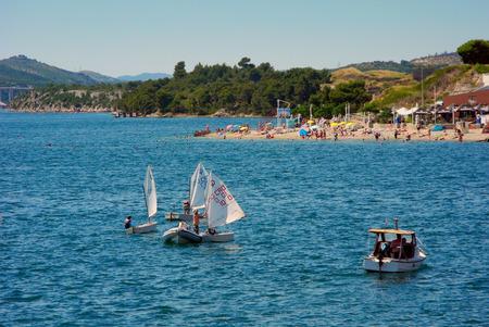 Sibenik, Croatia - July 5, 2016: Boats near the public beach in midsummer. Editorial