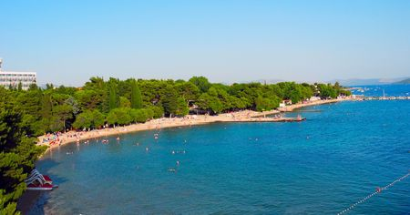 View from the pier on the beach with pines in Vodice, Croatia. Banco de Imagens