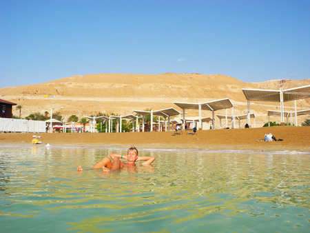 recuperation: The girl in the curative waters of the Dead Sea.
