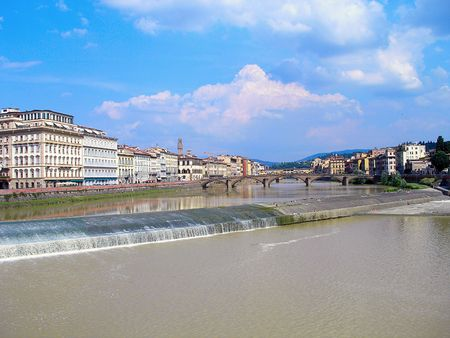 river arno: River Arno and the famous bridges of Florence in a hot summer day. Stock Photo