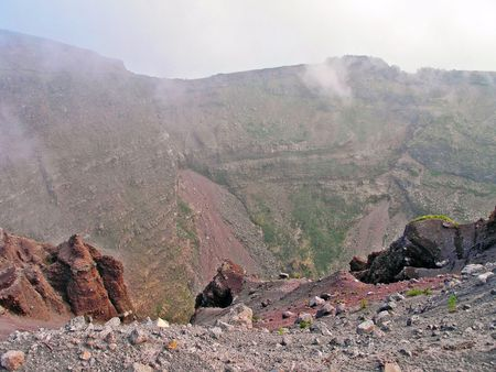 The smoking crater of the active volcano Vesuvius. Italy.