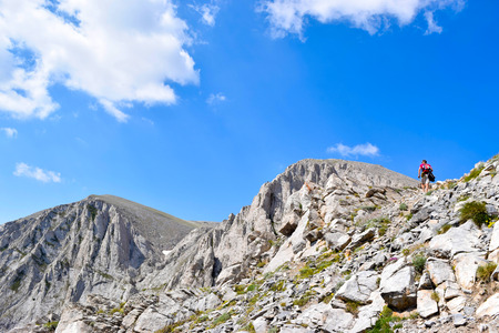 Man Climb to the top of Olympus, highest mountain in Greece.