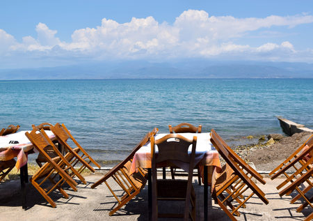 Dining tables by the sea in Kamena Vourla, Greece.