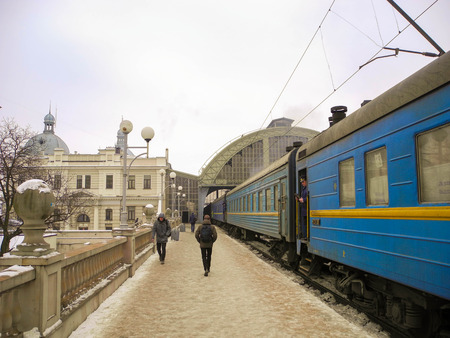 Lviv, Ukraine - February 01, 2017: Passengers on the perron near the train at central railway station. Editorial