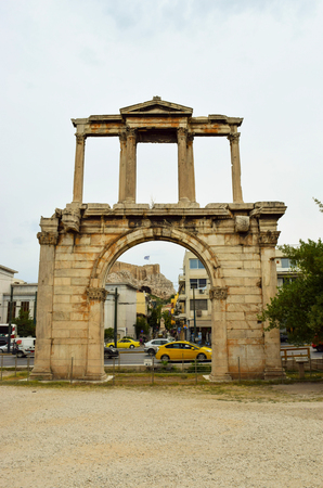 Arch of Hadrian on the background of Athenian Acropolis.