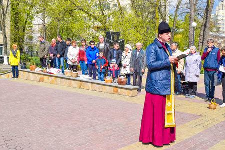 Kiev, Ukraine - April 16, 2017: The clergyman near the church during the Easter service.