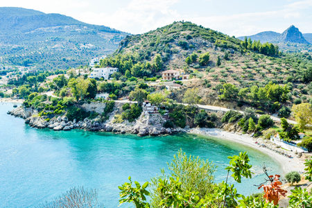 Landscape of the Asini small beach and the Tolo resort town, Peloponnese, Greece.