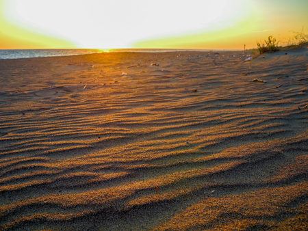 Untouched sand on the deserted Kaifas beach at sunset, Greece.