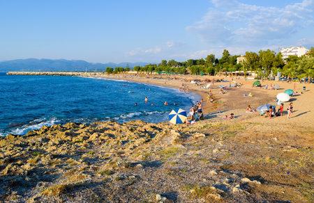 Greece - July 20, 2017: Vacationers sunbathe and swim on the beach of Kyparissia. Editöryel