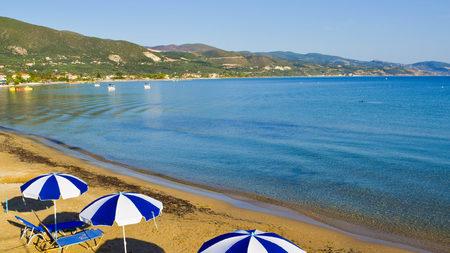 Sunbeds and umbrellas on the Alikanas beach, Zakynthos Island, Greece.