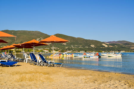 Alikanas, Zakynthos Island, Greece - 26 July, 2017: Sunbeds and umbrellas on the Alikanas beach, Zakynthos Island, Greece. Editorial