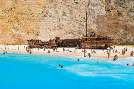 Shipwreck Bay, Zakynthos Island, Greece - July 26, 2017: Tourists on the Shipwreck Beach. Editorial
